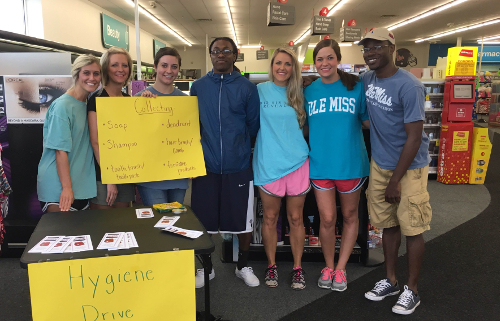 Ole Miss basketball player Stefan Moody (middle) showed up during the SOE's Hygiene Drive for Lovepacks on April 30.