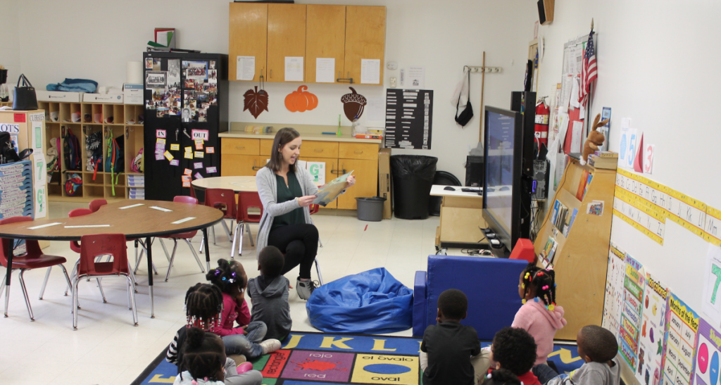 Teacher reading to students at a Water Valley day care center.